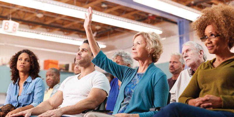 Woman raising hand in meeting